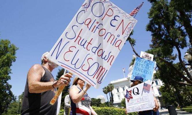 تظاهرات في مدن أميركية لرفع الإغلاق المفروض