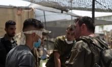 الاحتلال يعتقل 21 فلسطينيا بمداهمات في الضفة
