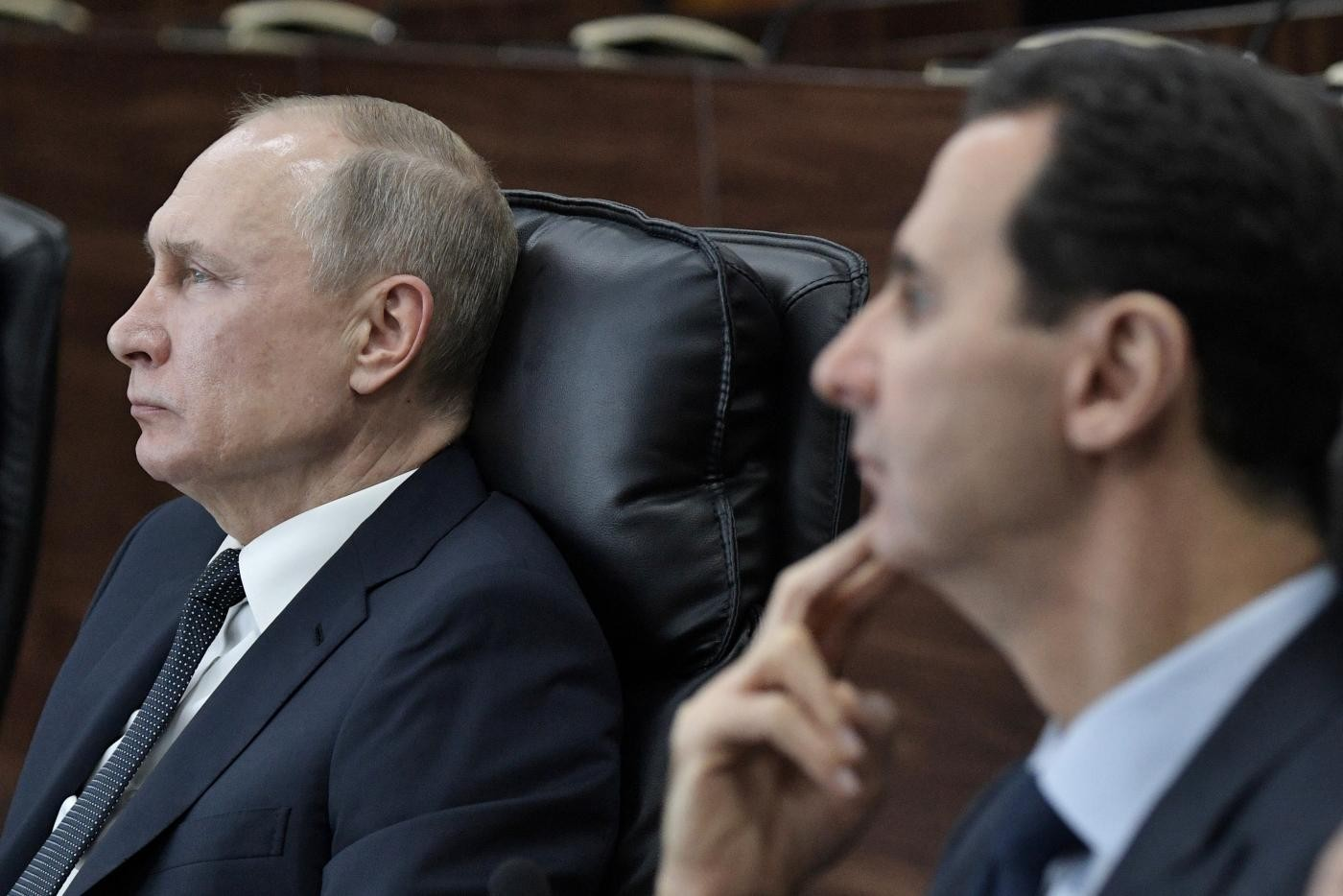 الأسد وبوتين (أ ب)