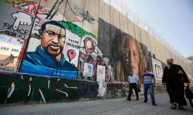 بجانب رسم عهد التميمي... الأميركي فلويد على الجدار الفاصل
