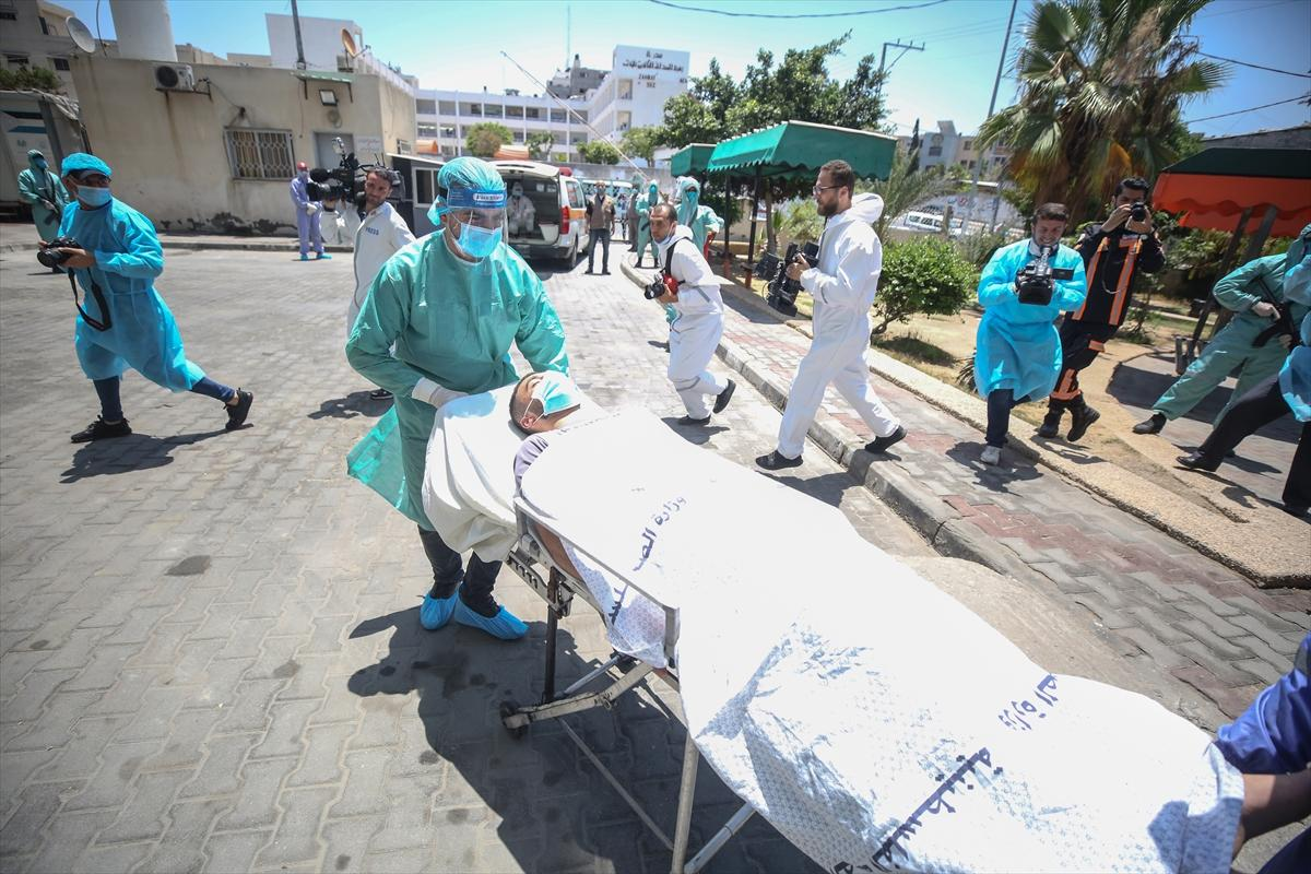 غزة: مناورة تدريبية تحاكي إجلاء مصاب بكورونا في حي مكتظ