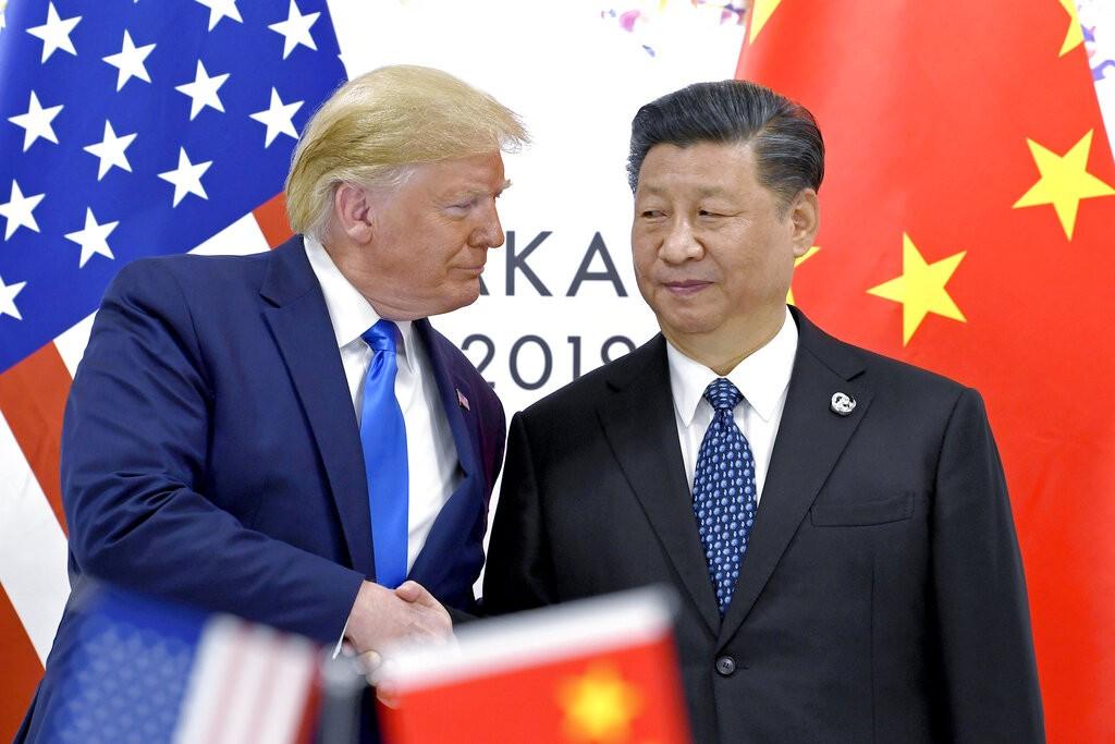 ترامب والرئيس الصيني (أ ب)