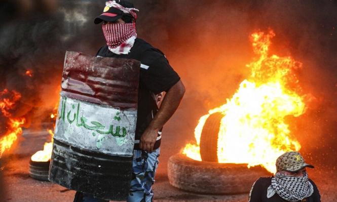 محتجون عراقيّون يضرمون النار بمكتب البرلمان في البصرة