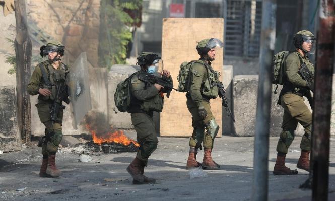 مواجهات واعتقالات بالضفة وإخطارات هدم بالخليل