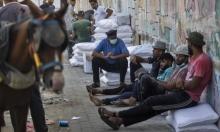 """تحذيرات: """"كارثة إنسانيّة"""" تواجه عمال غزة"""