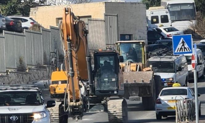 الاحتلال يعتقل بكيرات ويهدم مساكن ومحال تجارية بالقدس