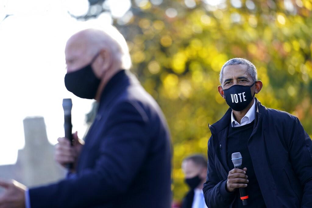 أوباما وبايدن (أ ب)