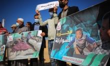 غزيّون يحيون الذكرى الأولى لمجزرة عائلة السواركة