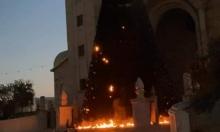 حرق شجرتي الميلاد في سخنين: استنكار وإعادة تزيينهما