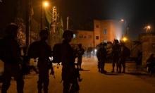 الاحتلال يعتقل 18 فلسطينيا في مخيم شعفاط