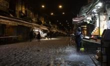 أحد أسواق القدس المحتلّة يكتسي بالثلج