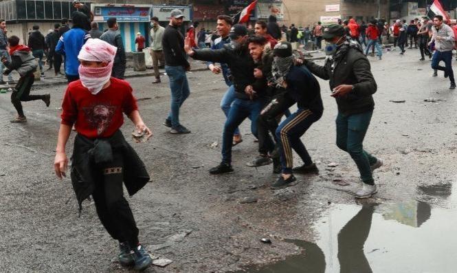 العراق: إصابة 15 متظاهرا وعنصر أمن باحتجاجات الناصرية
