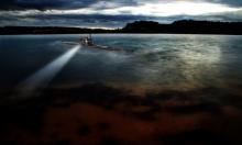 علماء روس ينصبون تلسكوبا عملاقا في أعماق بحيرة بايكال