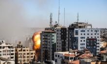 """لحظات قصف برج """"الرجاء"""" في غزة"""