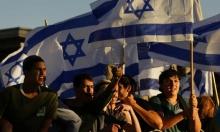 """القدس: إصابات واعتقالات في مواجهات مع الاحتلال و""""مسيرة الأعلام"""" تصل حائط البراق"""