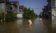 الصين: 99 قتيلا جراء فيضانات وتوتر مع وسائل الإعلام الأجنبية
