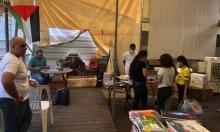 """بازار """"الشنطة"""" في الناصرة.. مشروع للتكافل وتبادل الكتب بين الطلاب"""
