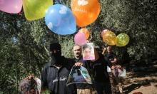 """غزة: إطلاق """"بالونات تحذيرية"""" تحمل رسائل وصور شهداء للاحتلال"""
